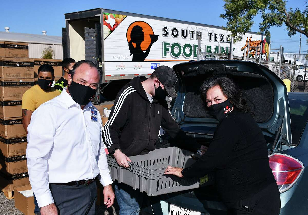 H-E-B Regional Director Douglas Gonzalez and South Texas Food Bank Executive Director Alma Boubel were on as both entities joined to hand out Thanksgiving dinners Wednesday, November 4, 2020. The distribution was part of the annual Feast of Sharing event. The H-E-B Meal Simple holiday dinners consisted of roasted turkey, green beans and mashed potatoes with garlic butter.