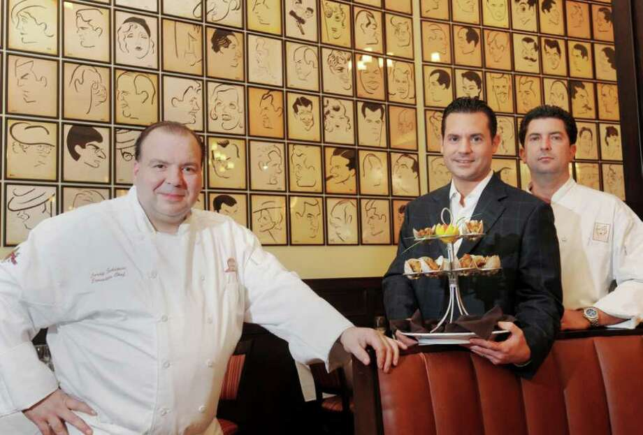 Executive Chef Larry Schepici, far left, worked with the Brown Derby's co-owners, Bobby and John Mallozzi, to give the restaurant a more affordable image. (Luanne M. Ferris / Times Union) Photo: Luanne M. Ferris
