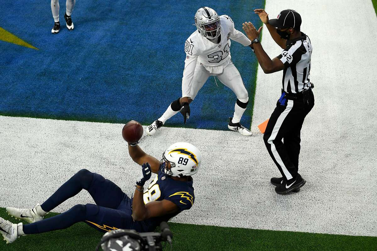 Donald Parham (89) of the Chargers comes down with the ball on the final play of the game. It was ruled a touchdown on the field, but after a replay review it was called an incomplete pass.