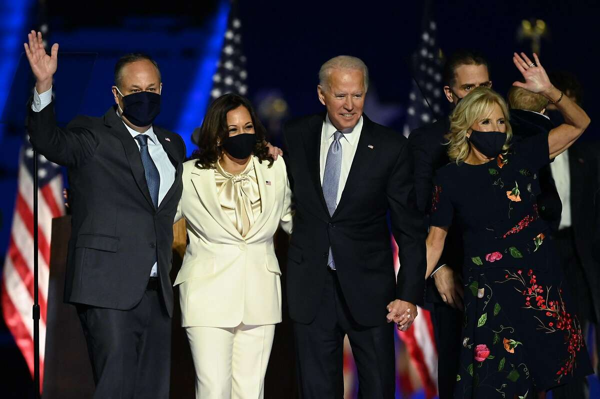 US President-elect Joe Biden and Vice President-elect Kamala Harris stand with spouses Jill Biden and Doug Emhoff after delivering remarks in Wilmington, Delaware, on November 7, 2020, after being declared the winners of the presidential election.