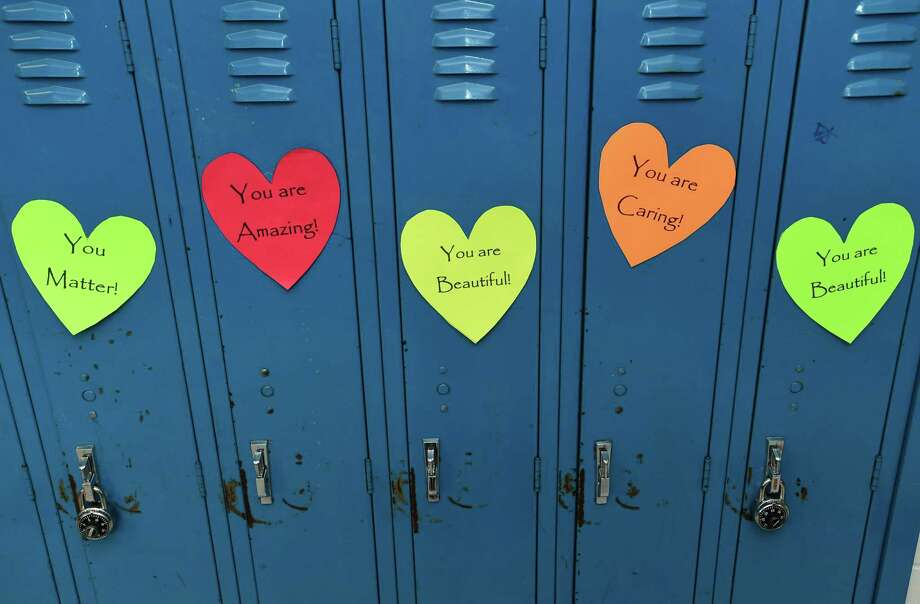 """Roton Middle School lockers Wednesday, February 13, 2019, after parents decorated lockers for """"Roton's Lockers of Love"""" to promote social-emotional wellness at the school in Norwalk, Conn. Photo: Erik Trautmann / Hearst Connecticut Media / Norwalk Hour"""