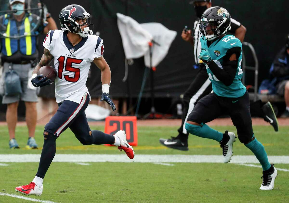 Will Fuller (15) sprints past Jaguars cornerback C.J. Henderson for a 77-yard score that gave the Texans receiver a touchdown catch in his team-record sixth consecutive game.