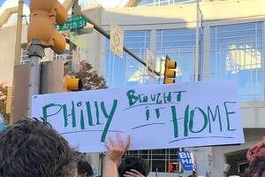 Biden supporters celebrate in the streets of Philadelphia Saturday.