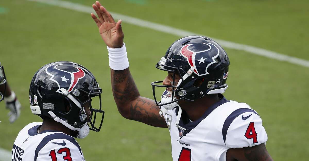Houston Texans quarterback Deshaun Watson (4) and wide receiver Brandin Cooks (13) celebrate Cooks' 57-yard touchdown reception against the Jacksonville Jaguars during the first half of an NFL football game at TIAA Bank Field Sunday, Nov. 8, 2020, in Jacksonville.