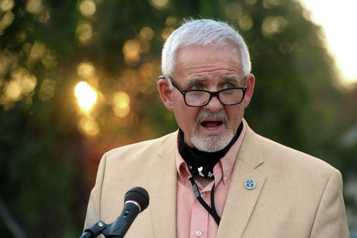 Tim Bolton, Mary Ellen Bolton's husband, speaks during a dedication ceremony for Mary Ellen Way, in front of Jane Ryan Elementary School, in Trumbull, Conn. Nov. 6. 2020.