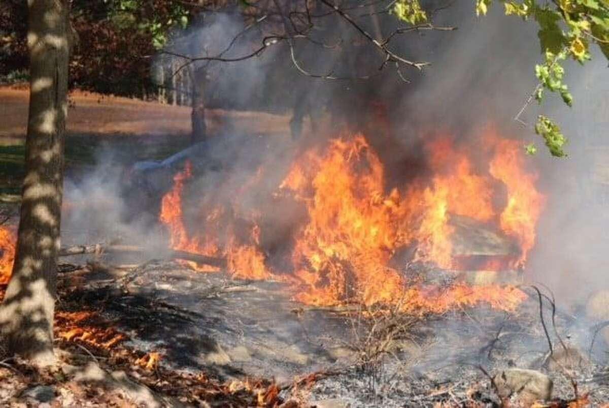 A car fire at Grove Cemetery in Naugatuck, Conn., on Sunday, Nov. 8, 2020.