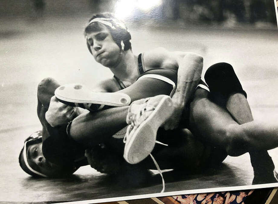 Edwardsville's Derek Baugh wrestles during his senior season in 1991. Baugh capped his prep career with a fourth-place finish at 171 pounds in the Class AA state tournament. Photo: For The Intelligencer