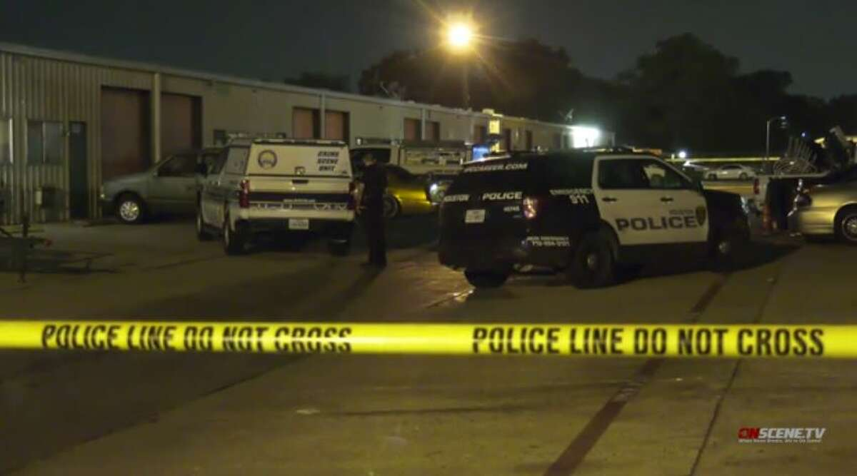 Police investigate a fatal shooting at a warehouse in southwest Houston on Monday, Nov. 9, 2020.