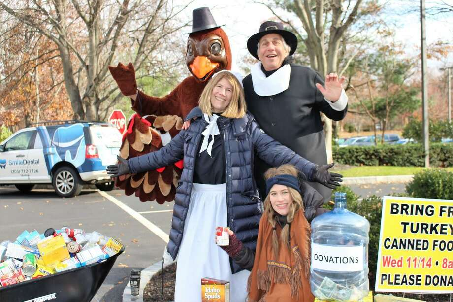 Dr. Bruce Sofferman, his wife, Deborah, and daughter Sophia, along with quite an enthusiastic turkey will be holding their 34th annual Thanksgiving food drive on Wednesday, Nov. 18. Photo: Bruce Sofferman / Contributed Photo / Connecticut Post