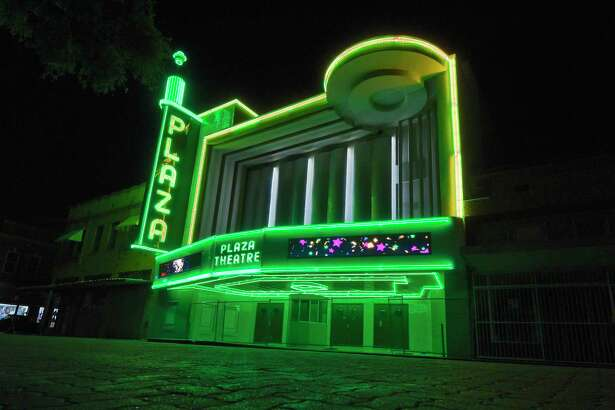 The Plaza Theater shines bright after missing and broken neon lights are replaced, June 14, 2019, in downtown Laredo.