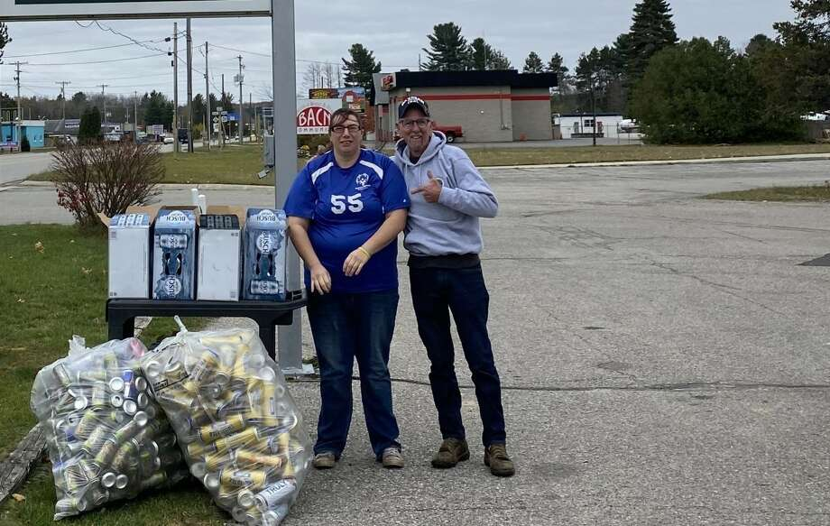 Katelyn Stachnik and Scott Jackson show off cans donated to the Special Olympics. Stachnik started a can drive to support the program and her fellow Olympians this summer, and Jackson was a frequent donor. (Courtesy Photo) Photo: (Courtesy Photo)