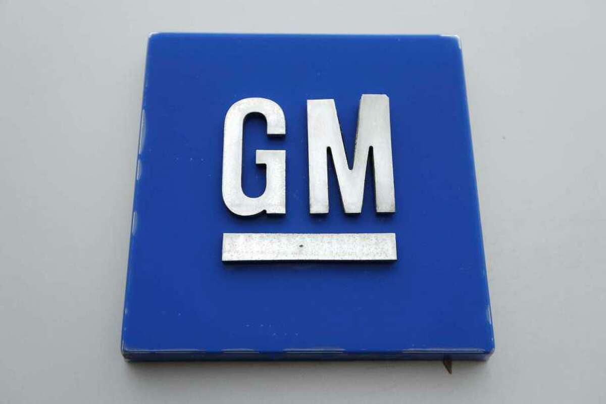 FILE - This Jan. 27, 2020 file, photo shows the General Motors logo in Hamtramck, Mich. General Motors is recalling more than 217,000 vehicles in the U.S. and Canada because transmission oil can leak, causing them to stop or catch fire.