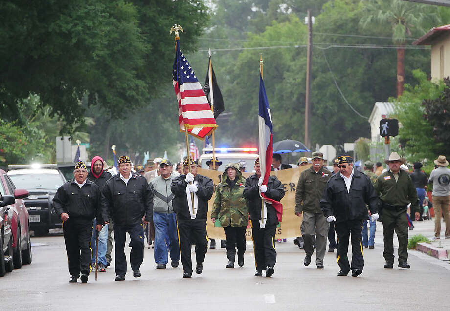 Military veterans along with high school ROTC, bands and cheerleaders marched along the streets of downtown Laredo from St. Peter's Plaza to San Agustin Plaza in honor of Veterans Day, Sunday, November 11, 2018. Photo: Cuate Santos/Laredo Morning Times