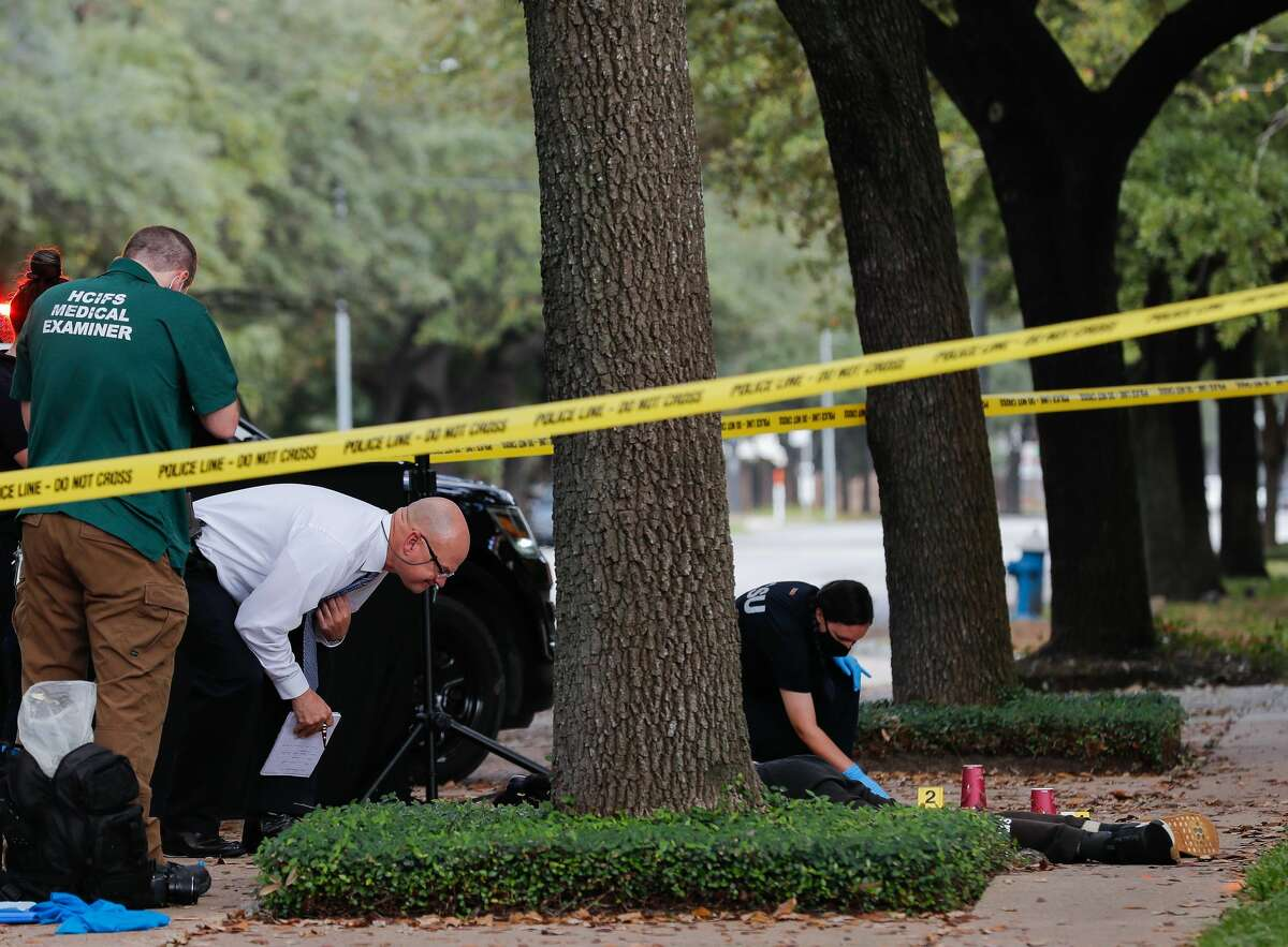 Houston Police homicide detectives investigate the scene where a man was found fatally stabbed on the sidewalk on Montrose Boulevard, near Richmond Avenue on Monday, Nov. 9, 2020, in Houston.