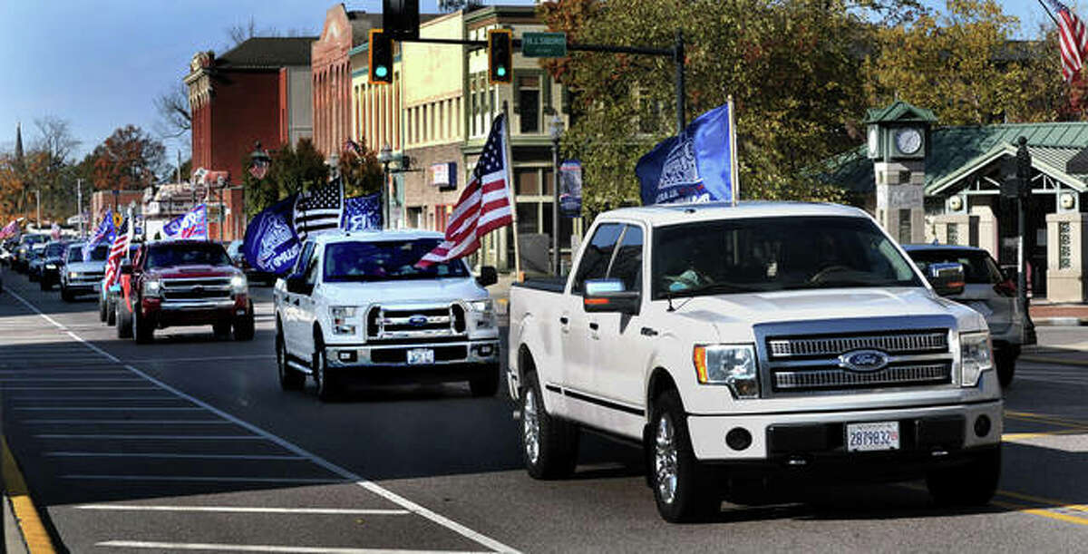 A large group of Trump supporter drove through downtown Edwardsville Nov. 1, starting around 1:15 p.m., shouting and honking their horns as they drove down North Main Street with several of the vehicles decorated with Trump and American flags.