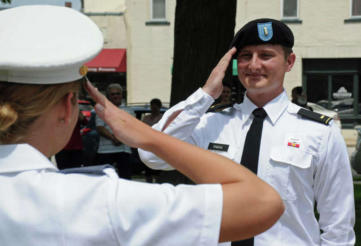 Newly-commissioned Army 2nd Lt. Gabriel Parish, right, receives his first salute from West Point Cadet Brooke Tuttle of Jerseyville during a May 23 ceremony at the Jersey County Courthouse.