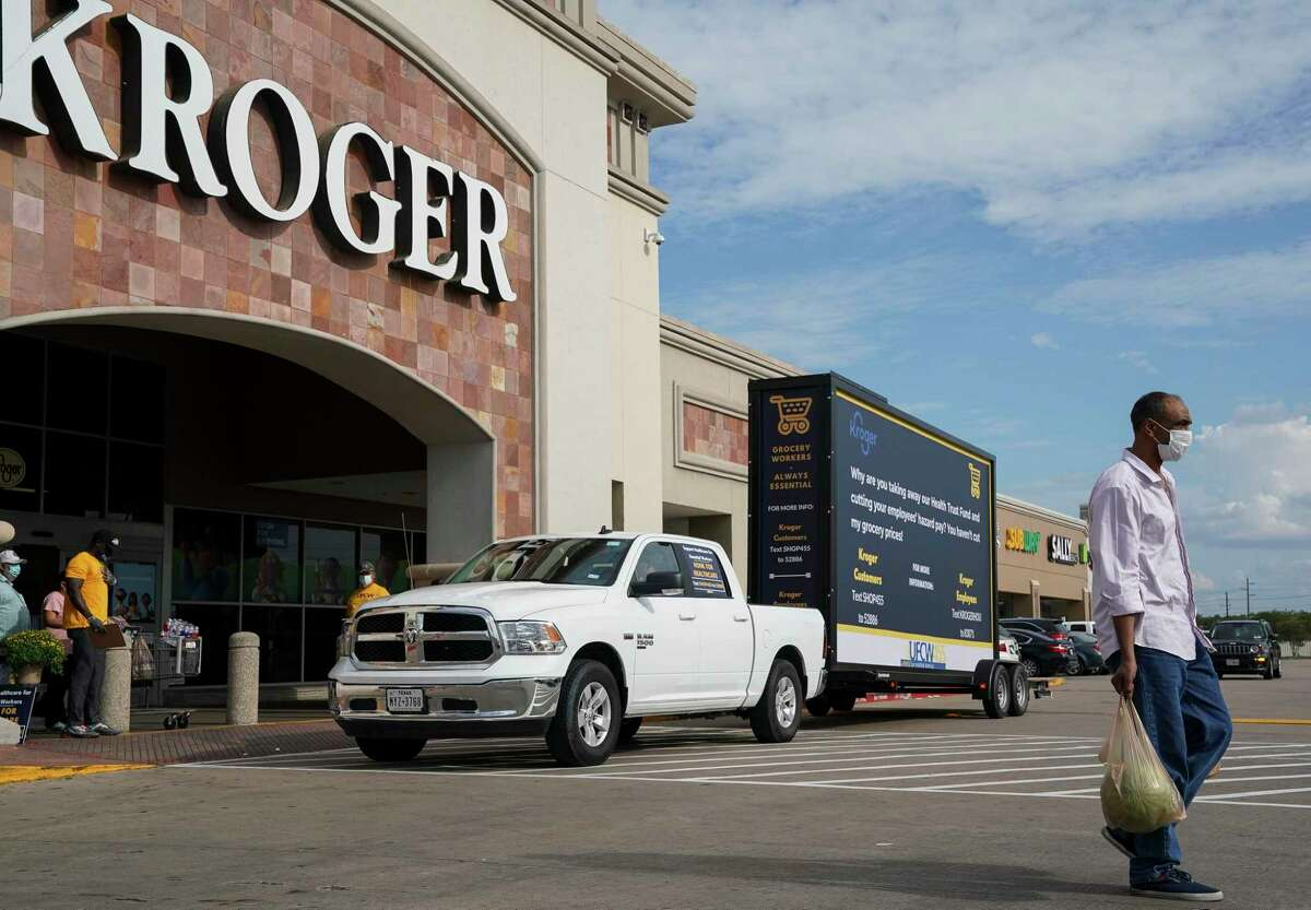 A vehicle with the United Food and Commercial Workers International Union circles the parking lot of a Kroger store during a rally Tuesday, Sept. 15, 2020, in Houston.