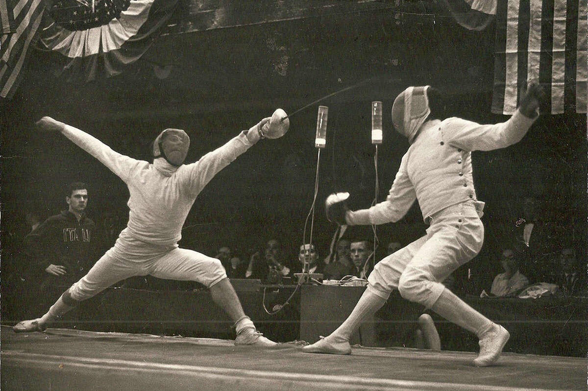 Classic lunge by Michael D'Asaro on the left. A textbook lunge.