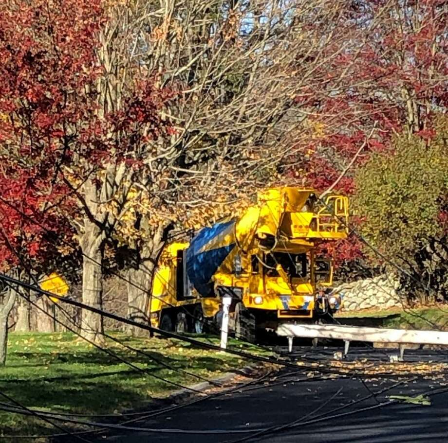 Power was knocked out to residents in the area of Birdseye Road Monday, Nov. 9, as utility crews repaired damage caused by a cement truck striking overhead power lines. Photo: Shelton Fire Department / Contributed Photo / Connecticut Post