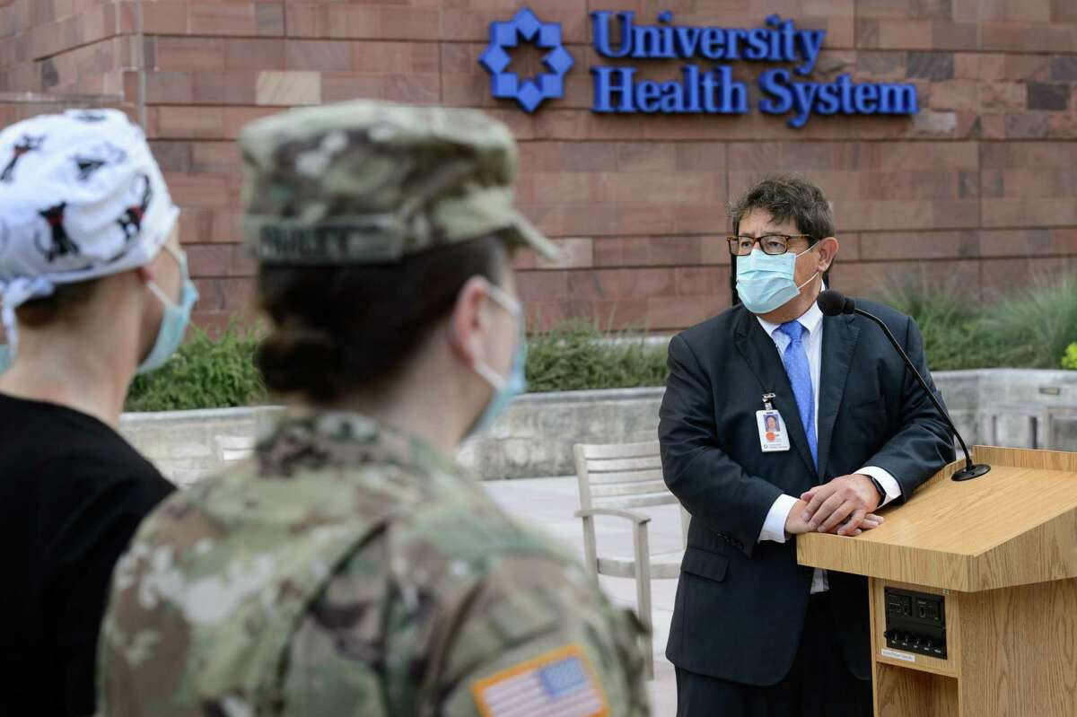University Health CEO George Hernandez speaks to U.S. Army service members deployed to assist with COVID-19 response at a Sept. 3 ceremony at University Hospital. The building has the Bexar County hospital system's old logo.