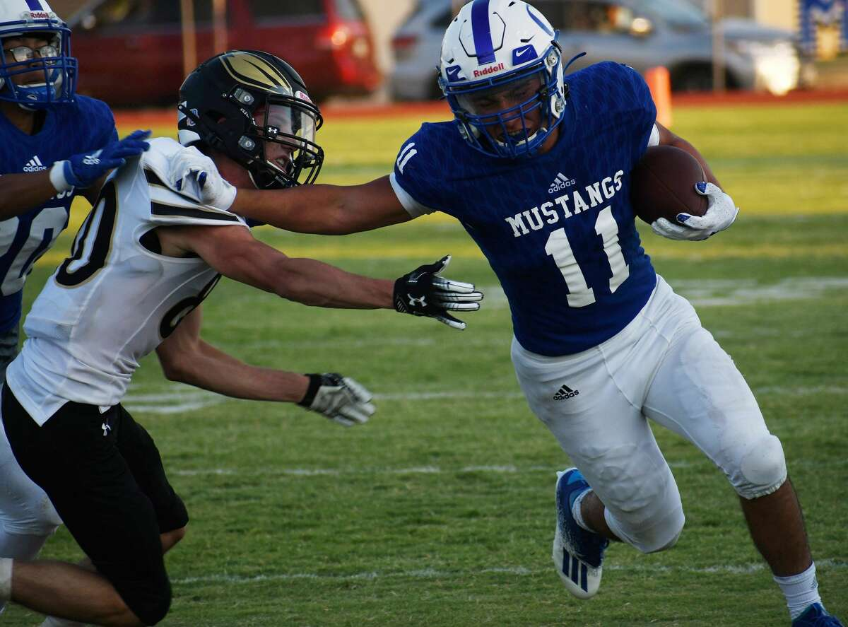 Olton's Aldo Vasquez takes the ball past a Sudan defender during their non-district football game on Aug. 28, 2020 in Olton.
