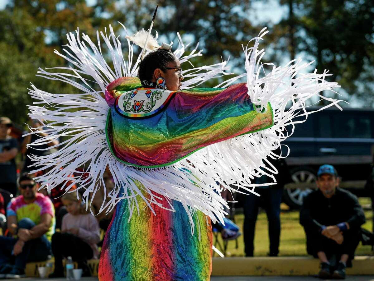 """Julianne Butler performs a fancy dance, used in time of war, as members of the Alabama-Coushatta perform dances and talk about the tribe's history at the Heritage Museum of Montgomery County, Saturday, Nov. 16 2019, in Conroe. The tribe will again be recognized on Saturday at the Heritage Museum as a part of the museum's """"Gathering of Nations"""" event."""