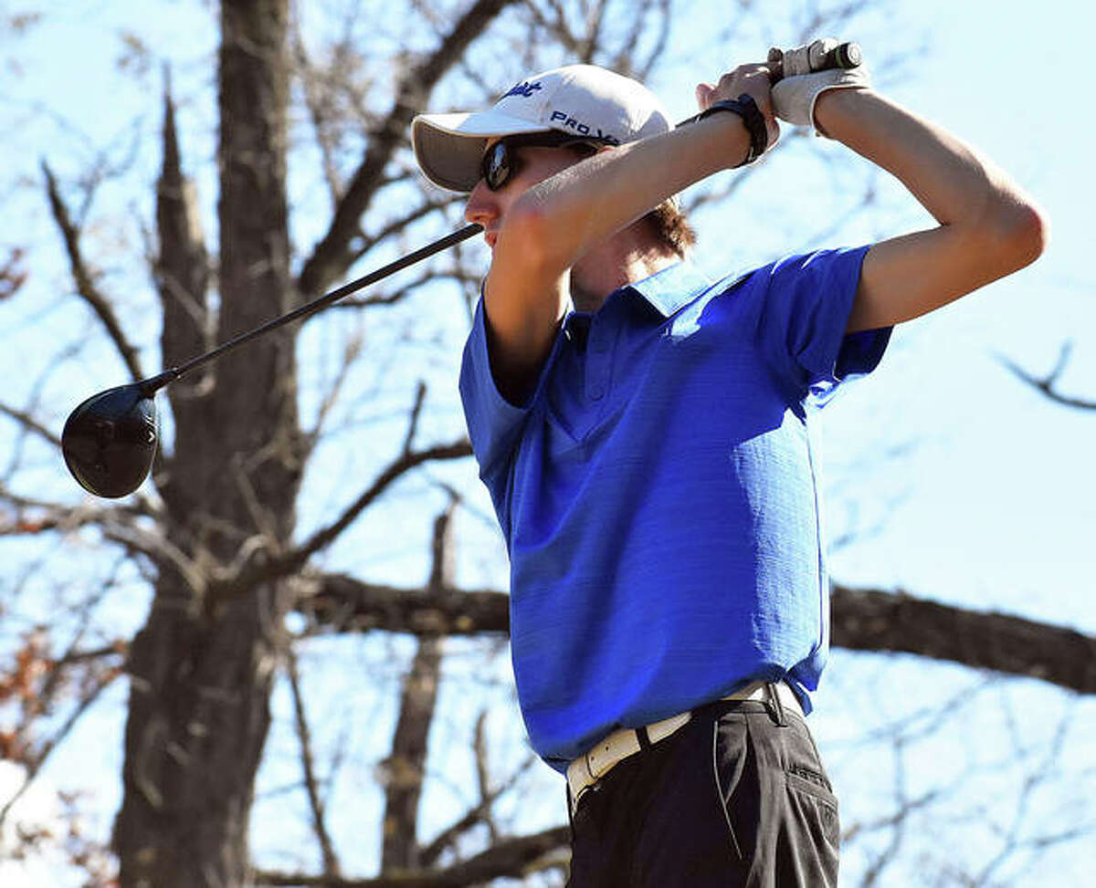 Marquette Catholic senior William Roderfeld watches his tee shot Saturday at Spencer T. Olin golf course on the first day of the Gateway PGA High School Championship.