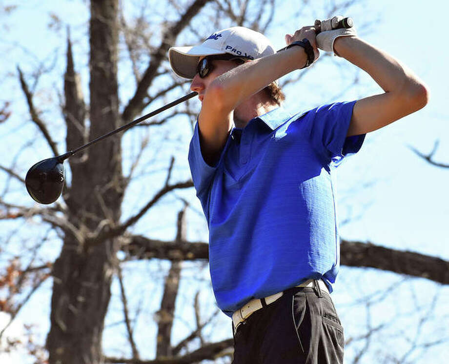 Marquette Catholic senior William Roderfeld watches his tee shot Saturday at Spencer T. Olin golf course on the first day of the Gateway PGA High School Championship. Photo: Matt Kamp / Hearst Illinois