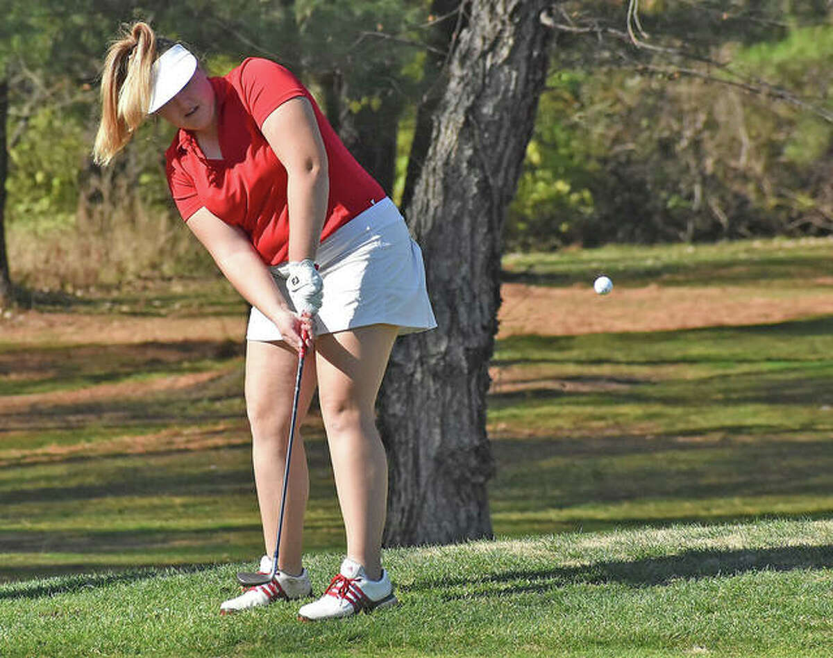 Alton senior Riley Kenney chips onto the green Saturday at Spencer T. Olin golf course on the first day of the Gateway PGA High School Championship.