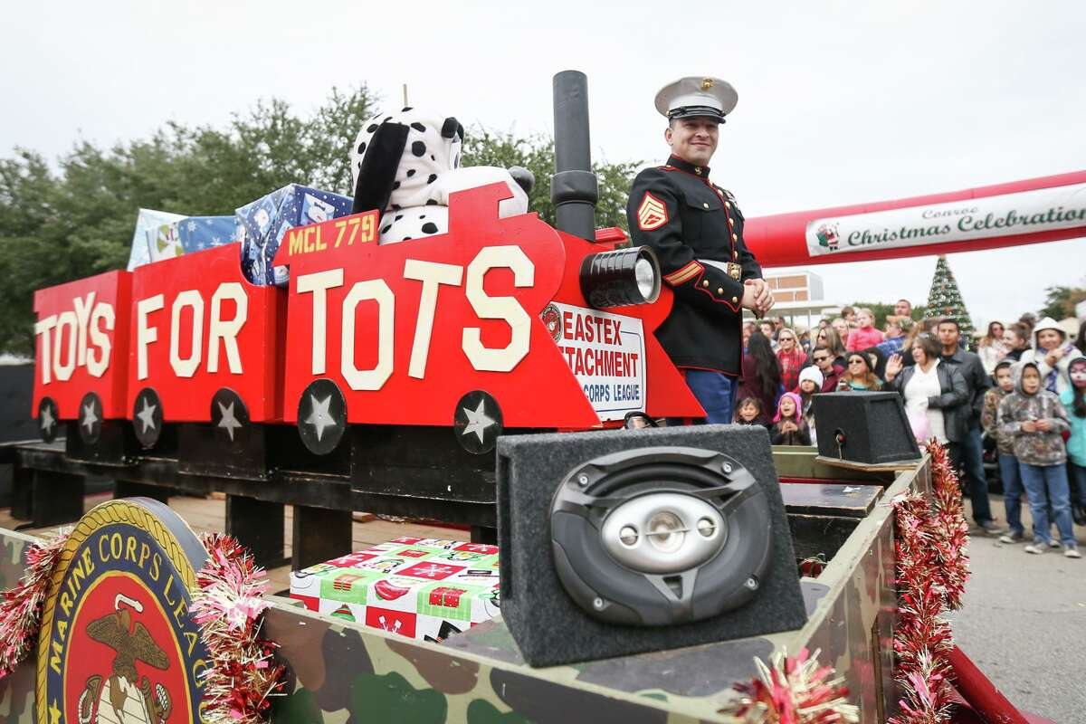 A Toys for Tots float manned by the Eastex Detachment Marine Corps League cruises through downtown Conroe during the Kiwanis Christmas Parade in 2016. Collection boxes are now out for this year's Toys for Tots collection.