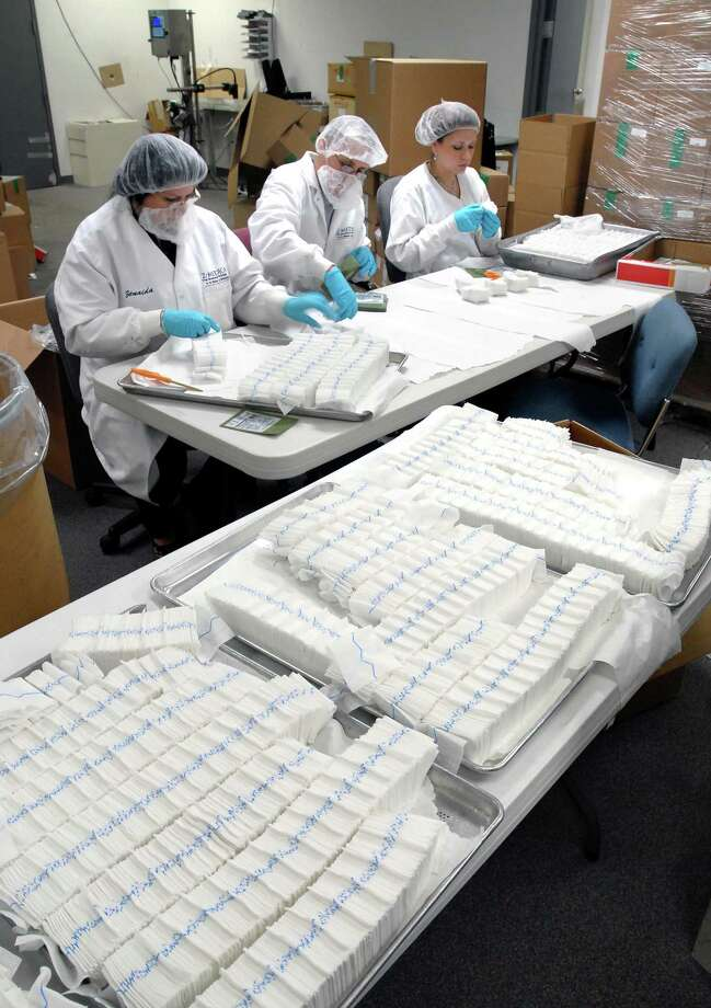 The latest version of QuikClot Combat Gauze is packaged at Z-Medica Corp. in Wallingford in 2009. Photo: Arnold Gold / Hearst Connecticut Media File