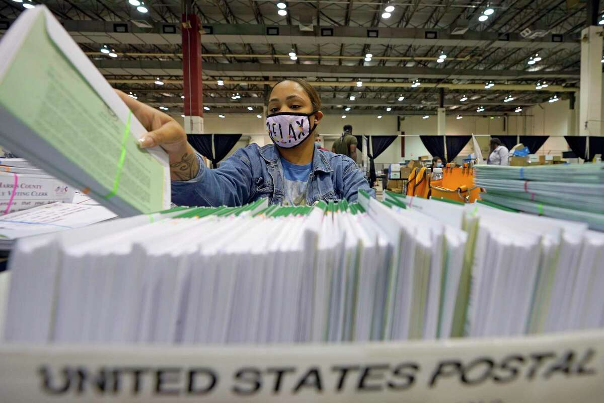 A Harris County election worker prepares mail-in ballots in September. President Donald Trump has made repeated unfounded claims of voter fraud - but there are ways to combat such allegations. to be sent out to voters Tuesday, Sept. 29, 2020, in Houston. (AP Photo/David J. Phillip)