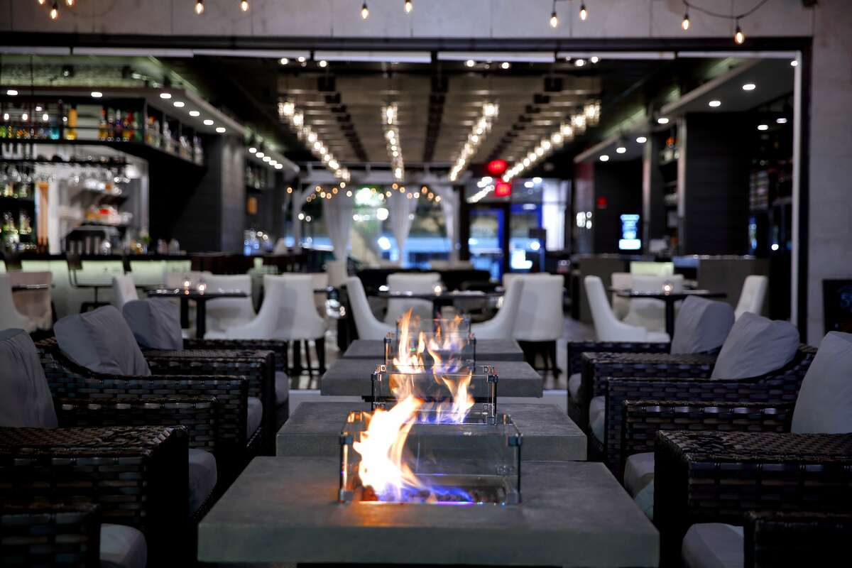 The Shaker & Vine's indoor fire pits, which set the mood. The Schenectady restaurant had igloo-like structures for outdoor dining, but will not continue using those in the winter of 2020.