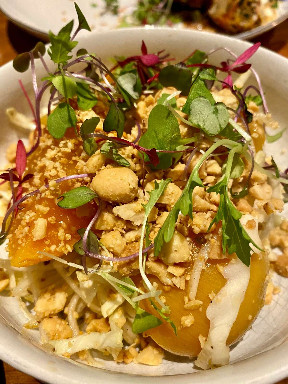 Golden beet salad nods to a Thai preparation with peanuts, herbs and brown-sugar vinaigrette at Local 111 in Philmont. (Susie Davidson Powell for the Times Union.)