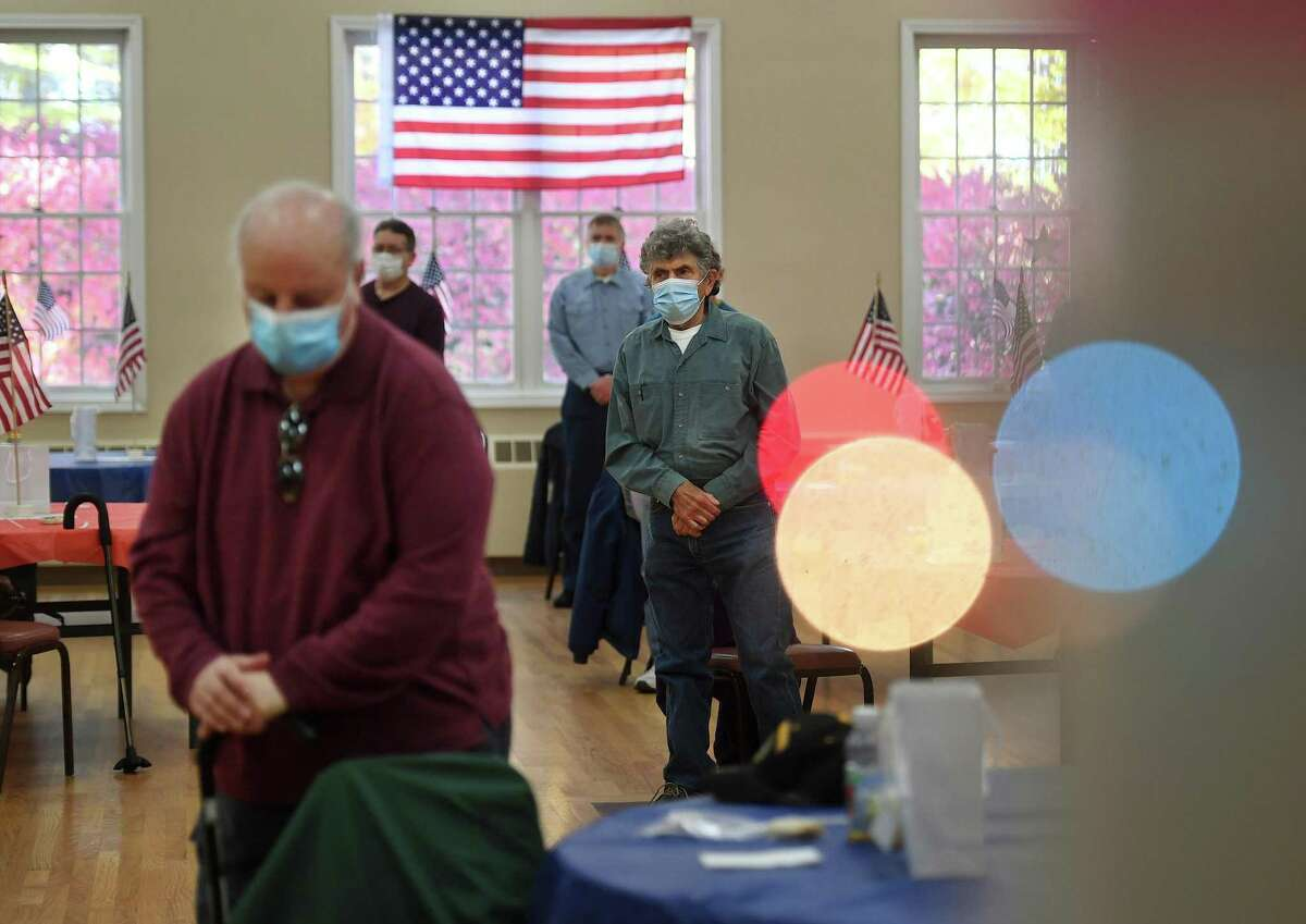 Veterans stand and bow their heads during the Veterans Day ceremony at the Shelton Senior Center on Monday, November 9, 2020.
