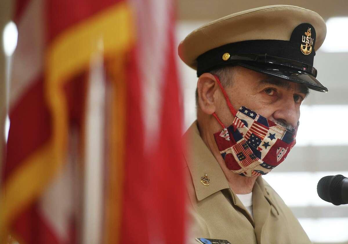 Navy veteran Dennis Salzer addresses fellow veterans during a socially-distanced Veterans Day ceremony at the Shelton Senior Center on Monday, November 9, 2020.