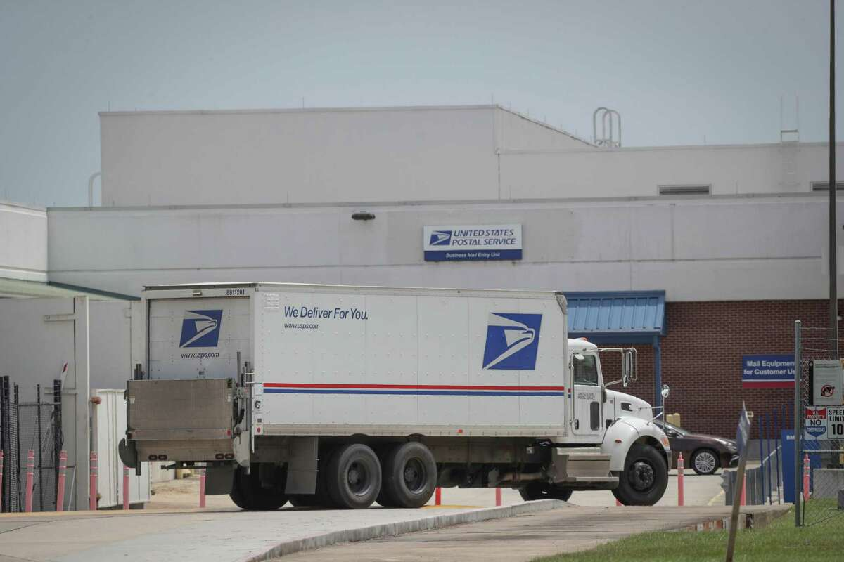 A United States Postal semi-truck arrives at the USPS office 4600 Aldine Bender Rd., Monday, Aug. 17, 2020, in Houston.