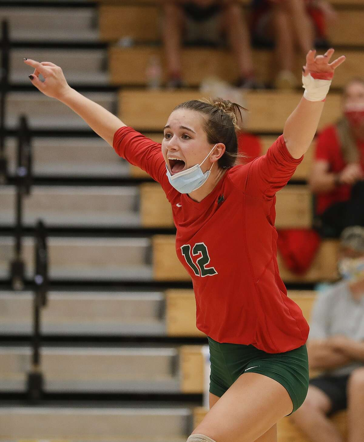 The Woodlands setter Clara Brower (13) reacts after a point during the fourth set of a District 13-6A high school volleyball match at Grand Oaks High School, Tuesday, Oct. 20, 2020, in Spring.