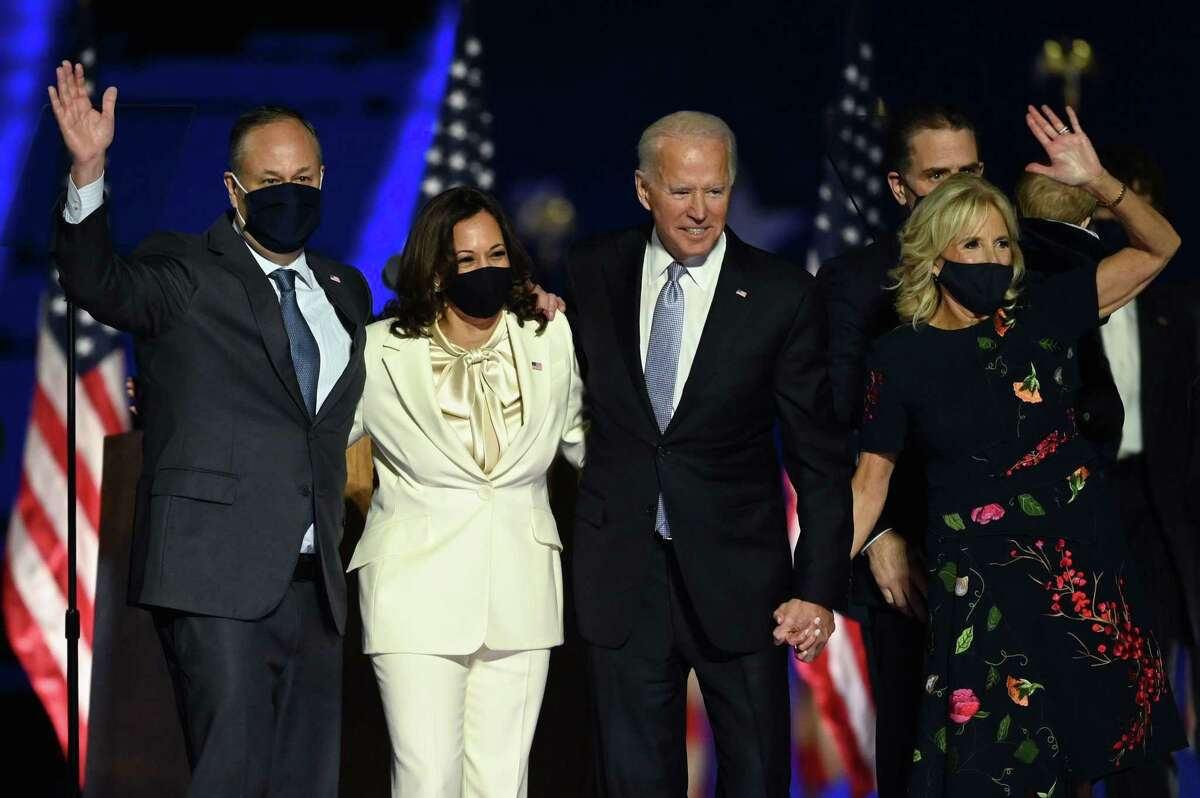 President-elect Joe Biden and Vice President-elect Kamala Harris stand with spouses Jill Biden and Doug Emhoff after delivering remarks in Wilmington, Delaware.