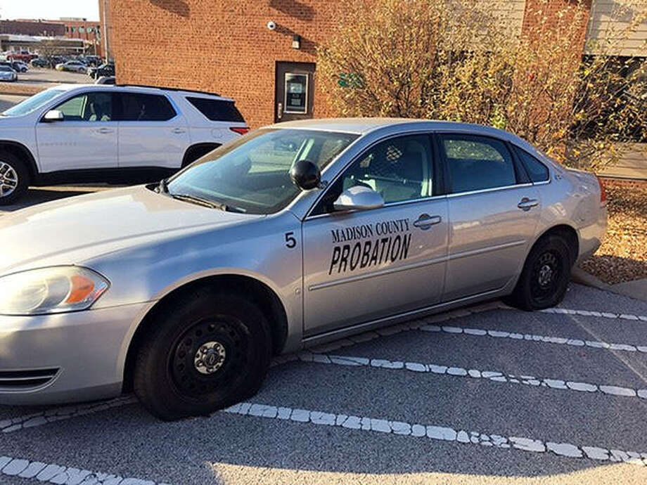 This Chevrolet Impala has four of the 28 flat tires found on county-owned vehicles Sunday. Photo: Courtesy Of Madison County