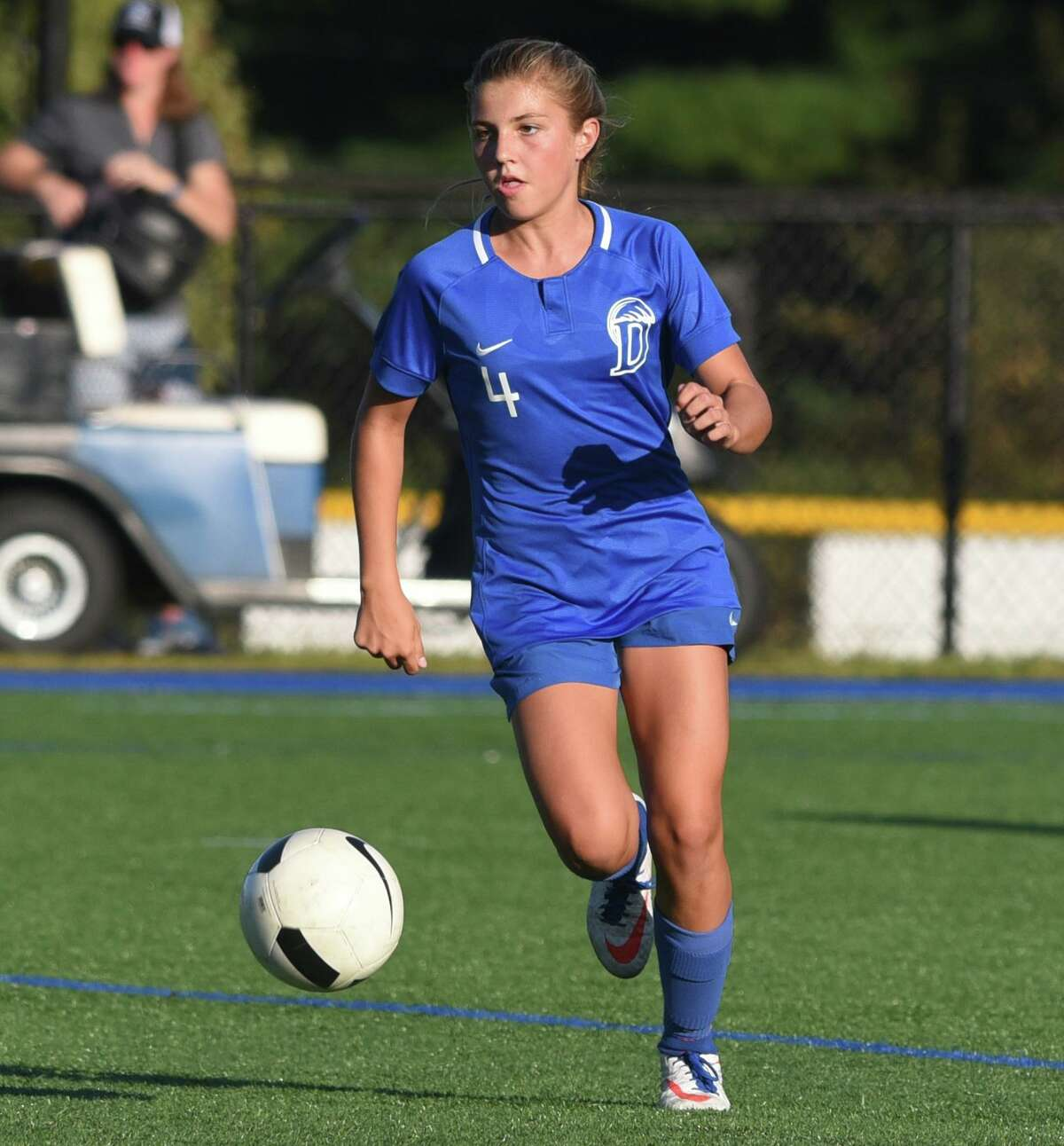 Darien's Chloe Humphrey (4) looks for an opportunity during a girls soccer game at Darien High School on Wednesday, Sept. 25, 2019.