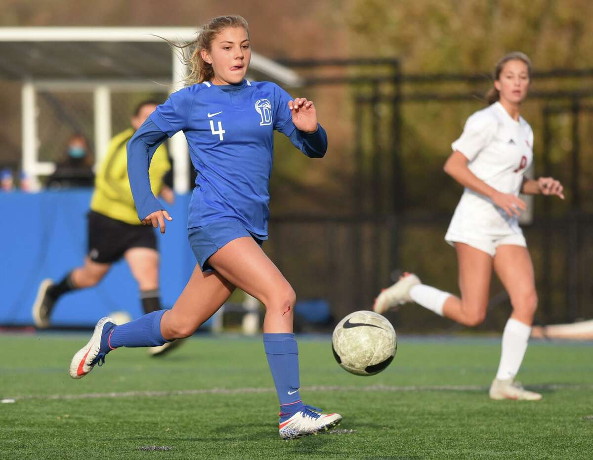 Darien's Chloe Humphrey (4) breaks away with the ball during the Wave's girls soccer game against New Canaan in Darien on Tuesday, Nov. 3, 2020. Humphrey had a hat trick as Darien won, 3-2.