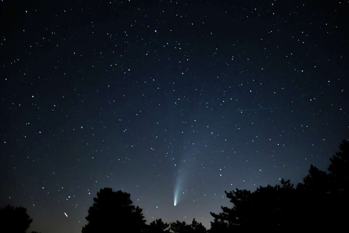 A meteor shower occurs when the Earth passes through the trail of debris left by a comet orasteroid.