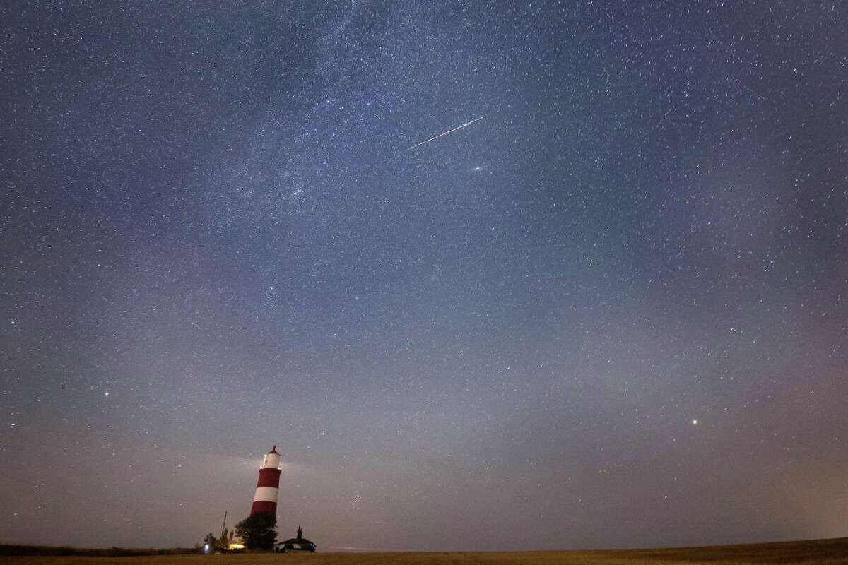A meteor during the Perseid meteor shower seen over Happisburgh lighthouse, Norfolk, as the Earth flies through a cloud of cometary dust creating a spectacular display of celestial fireworks. (Photo by Joe Giddens/PA Images via Getty Images)