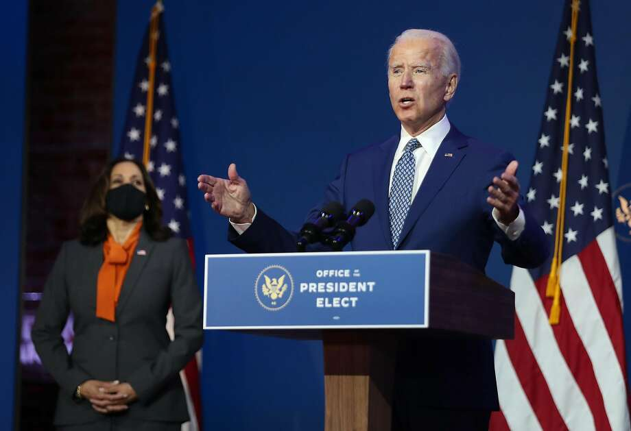 WILMINGTON, DELAWARE - NOVEMBER 09: U.S. President-elect Joe Biden speaks to the media while flanked by Vice President-elect Kamala Harris, at the Queen Theater after receiving a briefing from the transition COVID-19 advisory board on November 09, 2020 in Wilmington, Delaware. Mr. Biden spoke about how his administration would respond to the coronavirus pandemic. (Photo by Joe Raedle/Getty Images) Photo: Joe Raedle, Getty Images