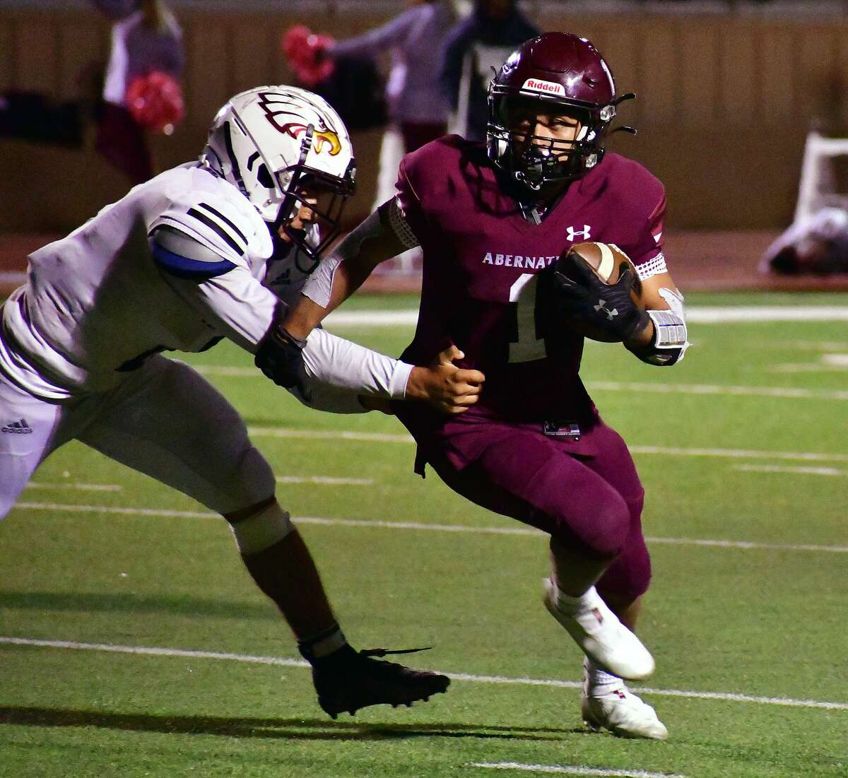 Abernathy's Malachi Reyes ducks around a Lubbock Roosevelt defender during their District 4-3A Division II football game on Oct. 23, 2020 in Abernathy.