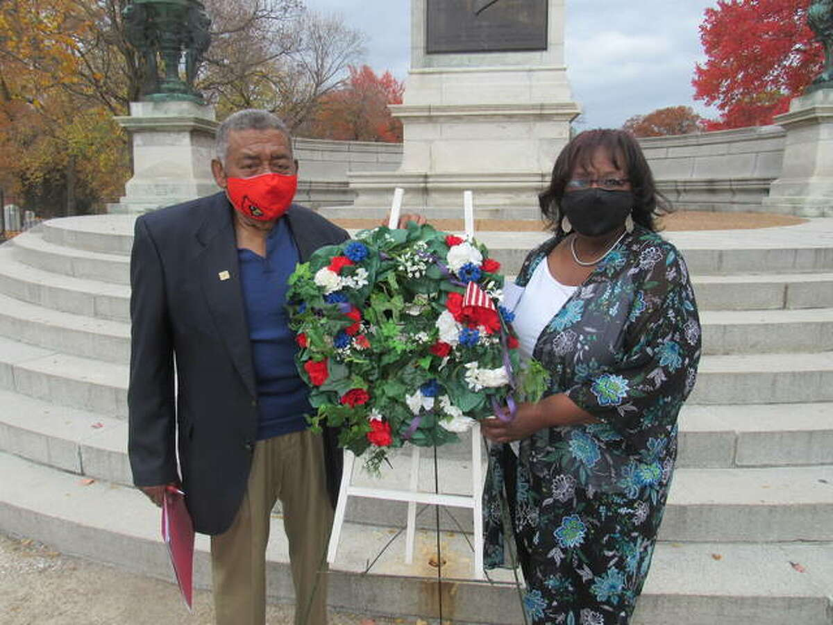 Lovejoy Committee Trustee Edmond Gray and President Bonnie Fox lay a wreath in front of the Lovejoy Memorial in Alton Monday afternoon.