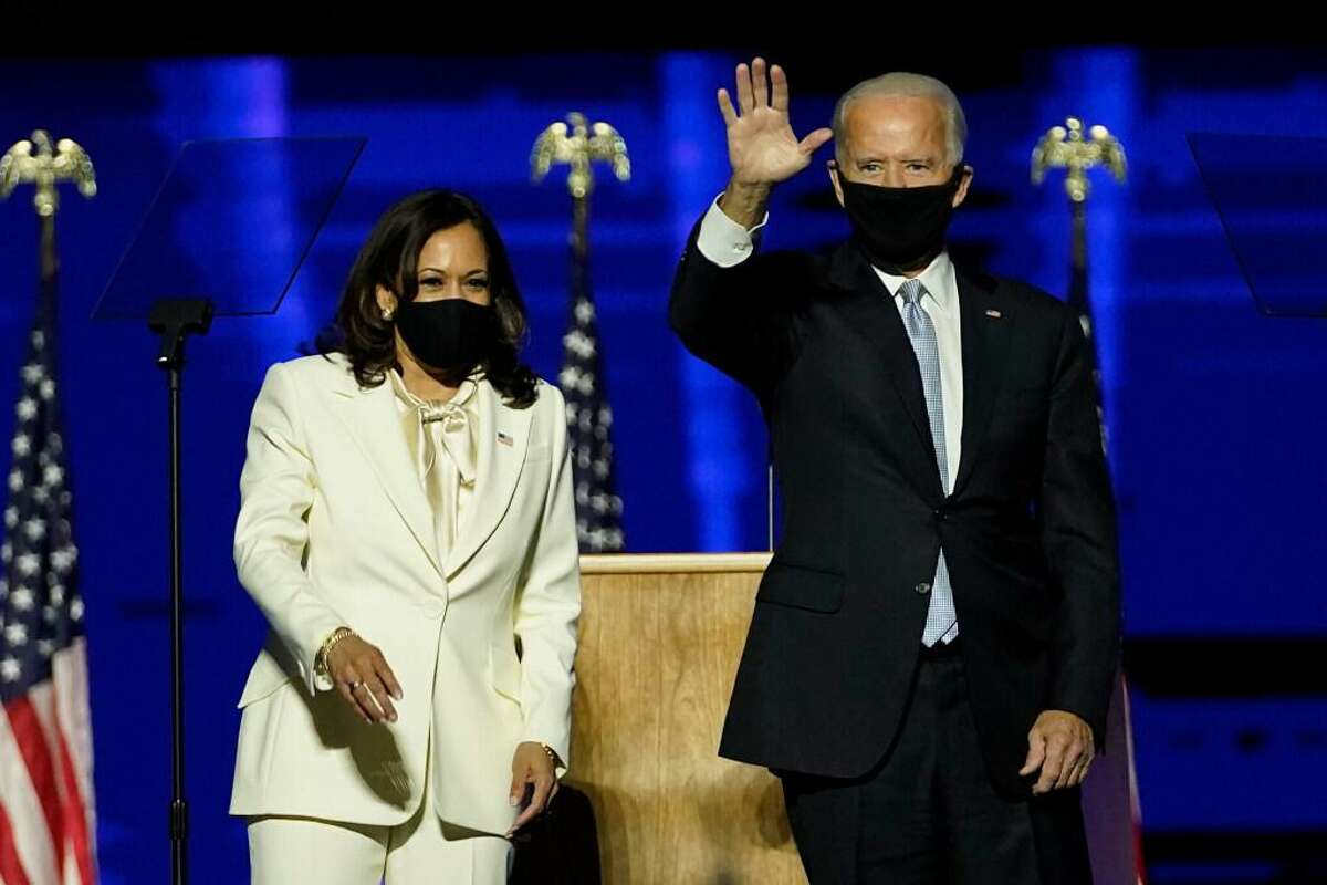 President-elect Joe Biden, right, on stage with Vice President-elect Kamala Harris, left, Saturday, Nov. 7, 2020, in Wilmington, Del.