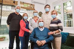 Group of senior people, wearing protective facemasks in nurisng home during coronavirus pandemic