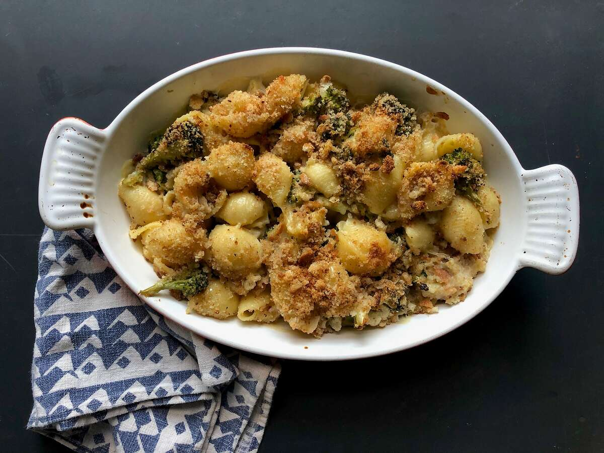 Roasted broccoli and shells mix with tangy crème fraiche, half-and-half and nutty cheese for a comforting dish.